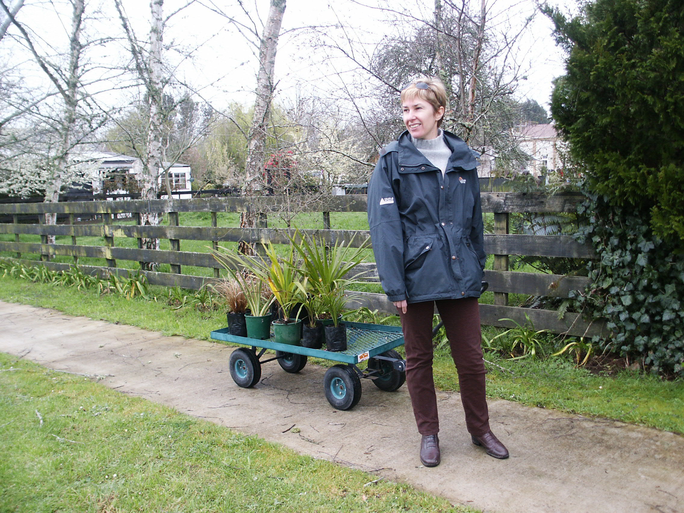 Jen with a local purchase for the garden. Essentially we built are garden one plant at a time and I held our budget in check by dividing plants as they grew.
