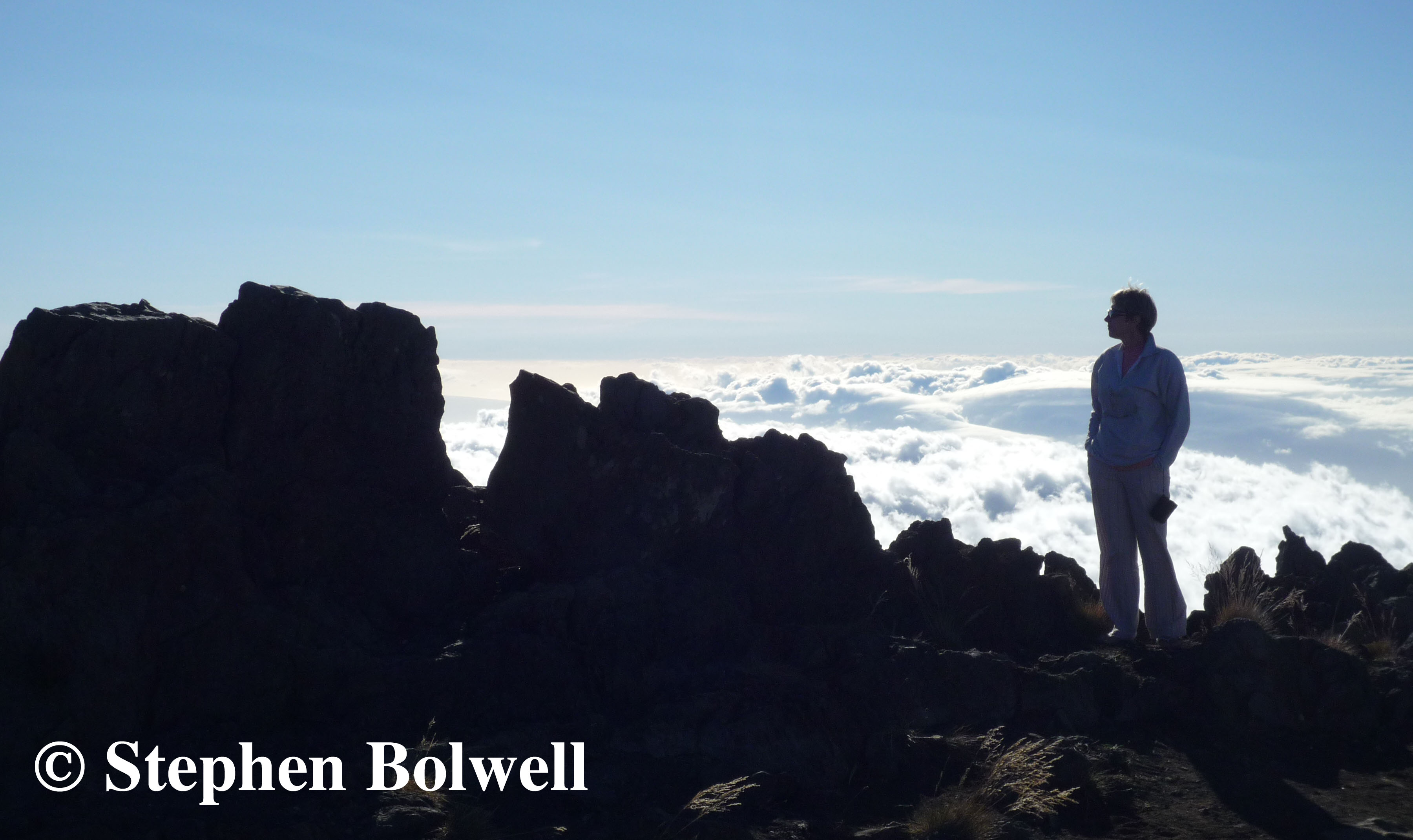 My wife Jen on Haleakala in 2010. Up above the clouds so high.