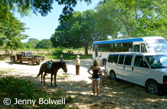 A bus which was quite a surprie to see squeezes by as I continue to work clearing sand from around the rear wheel whilst the rest of Mexico discusses what to do after I have failed to improve the situation.